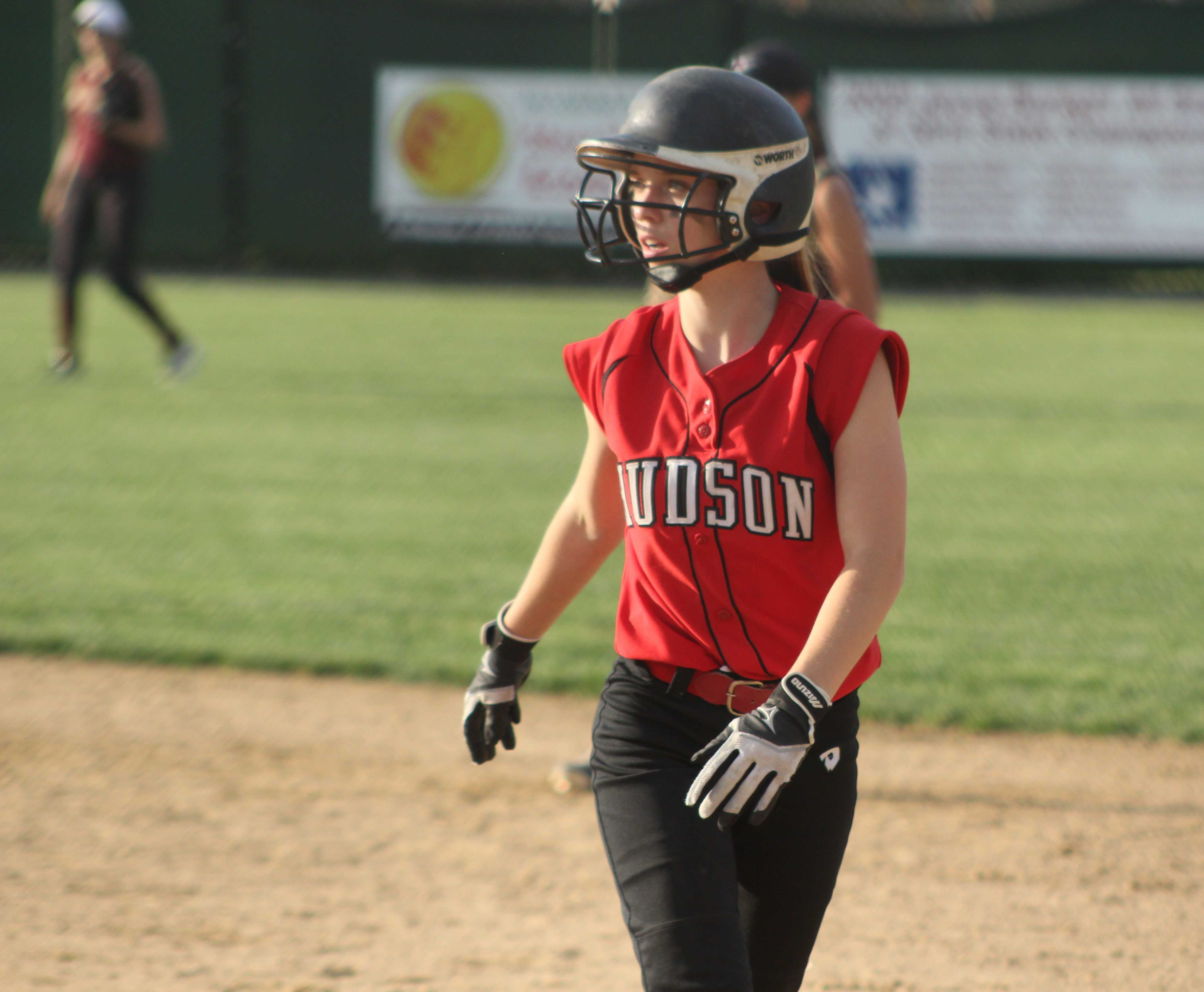 Senior Stephanie Hamilton stands at first base after hitting a single in the seventh inning vs. Doherty. | by Dakota Antelman